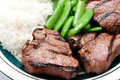 Grilled Lamb Chops With Tomato, Rice And Snap Peas Stock Photo - 63152070