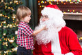 Surprised Little Boy Looks At Fake Santa Claus Royalty Free Stock Photography - 63193317