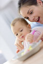 Baby Girl Wth Her Mother Eating Lunch Royalty Free Stock Image - 63200836