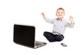 Cheerful Boy Sitting Before A Laptop Stock Photo - 63204420