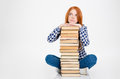 Thoughtful Female Put Head On Stack Of Books Royalty Free Stock Image - 63213196