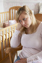 Mother In Nursery Suffering From Post Natal Depression Royalty Free Stock Photography - 63226907
