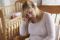 Mother In Nursery Suffering From Post Natal Depression Royalty Free Stock Photos - 63227318
