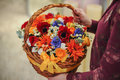 Basket With A Bouquet Of Colorful Flowers Stock Photos - 63256043