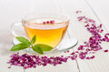 Glass Cup Of Tea With Mint And Dried Rose Petals Royalty Free Stock Photos - 63258318