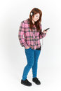 Full Length Cut Out Of Teenage Girl Listening To MP3 Player Royalty Free Stock Images - 63280609