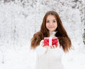 Young Girl With Small Red Gift Box Standing In Winter Forest Royalty Free Stock Photography - 63298177