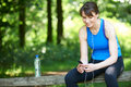 Middle Aged Woman Relaxing With MP3 Player After Exercise Stock Image - 63315051