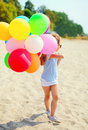 Little Girl Child With Colorful Balloons On Beach Royalty Free Stock Photo - 63316445