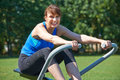 Middle Aged Woman Exercicing On Rowing Machine In Park Stock Images - 63317514
