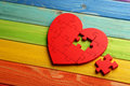Red Puzzle Heart Stock Photo - 63318600
