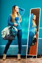 Fashion Woman Wearing Blue Denim In Front Of Mirror Royalty Free Stock Image - 63325296