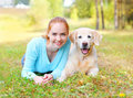 Happy Smiling Owner Woman And Golden Retriever Dog Lyin Royalty Free Stock Photo - 63338205