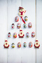 Chocolate Santas, Snowman And Biscuits Laying In A Form Of Chris Royalty Free Stock Images - 63338559