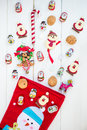 Chocolate Santas, Snowman And Biscuits Near Christmas Stocking Stock Images - 63338564