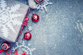Christmas Card With Handmade Paper Snowflakes, Gift Boxes And Red Decorations On Gray Rustic Background Stock Images - 63340604