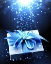 Gift With Blue Bow At The Sparks Stock Photos - 63419403