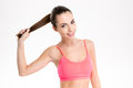 Amusing Cheerful Fitness Girl  Holding Her Long Hair In Ponytail Royalty Free Stock Image - 63435606