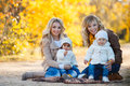Moms And Kids For A Walk In The Park In Autumn Stock Images - 63445764