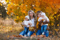Moms And Kids For A Walk In The Park In Autumn Stock Images - 63446444