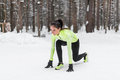 Fit Woman In Position Ready To Run Outdoors Winter Park Stock Photo - 63447620