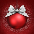 Christmas Ball With Silver Satin Ribbon Bow On Red Stock Photo - 63454380