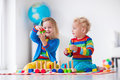 Kids Playing With Wooden Toy Train Stock Photo - 63465630