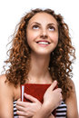Young Woman In Striped Vest With Red Book Stock Photo - 63467490