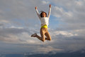 Young Beautifull Girl Oa A Peak Of A Mountait Jumping Royalty Free Stock Photo - 63485365