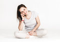 Portrait Of A Pretty Young Woman Girl Sitting On The Floor Isolated On White Royalty Free Stock Photography - 63493477
