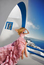 Beautiful Blond Runaway Bride In White Wedding Dress Fabulous With A Very Long Train Of Crystals In The Street On Santorini Stock Photo - 63538280