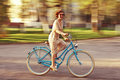Cheerful Girl On A Bicycle Royalty Free Stock Photography - 63541617