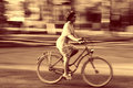 Young Girl On Bike In Movement Royalty Free Stock Images - 63541719