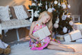 Girl Near Christmas Tree With Presents And Toys, Boxes, Christmas, New Year, Lifestyle, Holiday, Vacation, Waiting For Santa Stock Image - 63558701