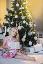 Girl Near Christmas Tree With Presents And Toys, Boxes, Christmas, New Year, Lifestyle, Holiday, Vacation, Waiting For Santa Royalty Free Stock Photography - 63558757
