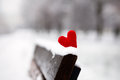Heart On The Snow-covered Bench Stock Photography - 63564992