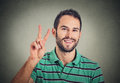 Headshot Young Man, Handsome Student Holding Up Peace Victory, Two Sign Stock Photography - 63603412