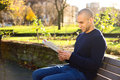 Reading In The Park Royalty Free Stock Photography - 63609197