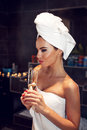 Woman With Towel Holding Glass Of Champagne Royalty Free Stock Image - 63658306