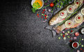 Food Background For Fish Dishes Cooking With Various Ingredients. Raw Char With Oil, Herbs And Spices On Cutting Board , Top View. Stock Photo - 63689570