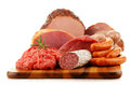 Meat Products Including Ham And Sausages On White Royalty Free Stock Photo - 63696345