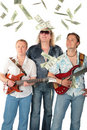 Three  Men With Two Guitars And Falling Dollars. M Royalty Free Stock Image - 6372276