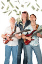Three  Men With Two Guitars Look On Falling Dollar Royalty Free Stock Photo - 6372305