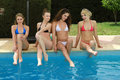 Women By The Pool Royalty Free Stock Photography - 63734297