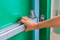 Hand Is Pushing/opening The Emergency Fire Exit Door Stock Photos - 63755393