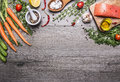 Salmon Fillet With Delicious Ingredients For Cooking A Variety Of Vegetables And Herbs, Salt In The Wooden Spoon, Cherry Tomatoes, Royalty Free Stock Photography - 63781267