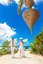 Happy Bride And Groom Having Fun On A Tropical Beach Under The P Stock Photos - 63795793