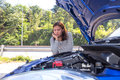 Asian Women Opened The Hood And Looking At Broken Down Car Royalty Free Stock Photos - 63857518