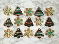 Gingerbread And Sugar Cookies Iced, Decorated With Candies For Christmas Royalty Free Stock Images - 63857669