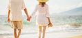 Mature Couple Walking On The Beach At Sunset Royalty Free Stock Photo - 63858705